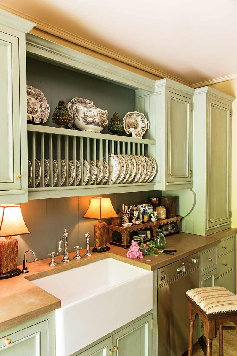 French-style light sage green kitchenette
