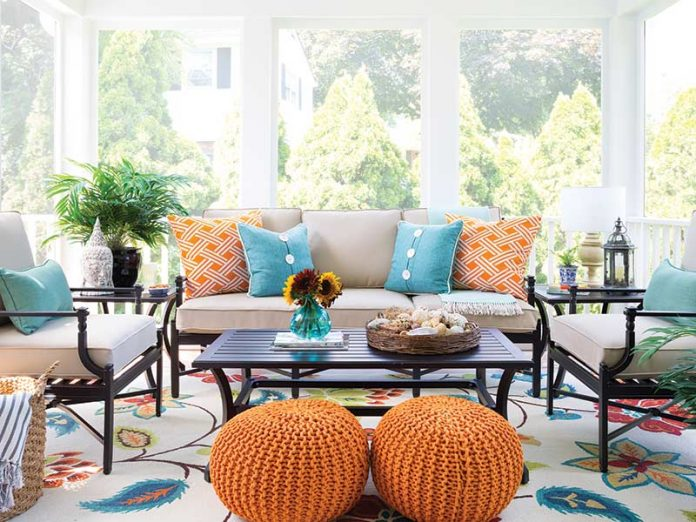 sunroom with vibrant orange hues paired with sea blues