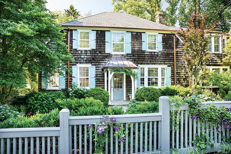 gray shingled home with light blue shutters