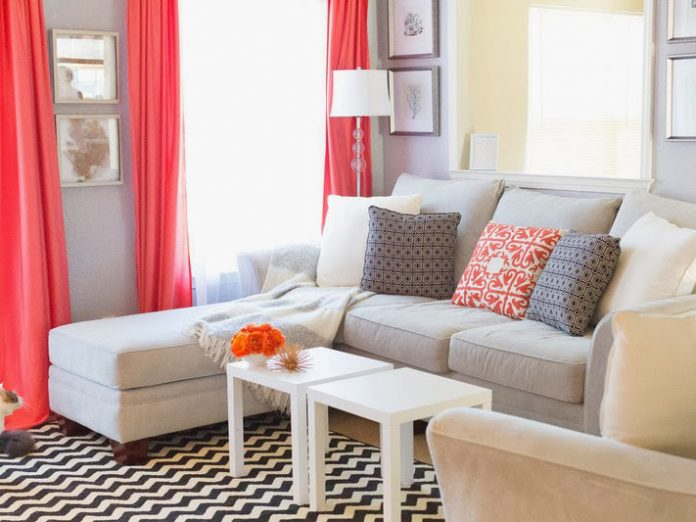 Neutral living room with coral curtains