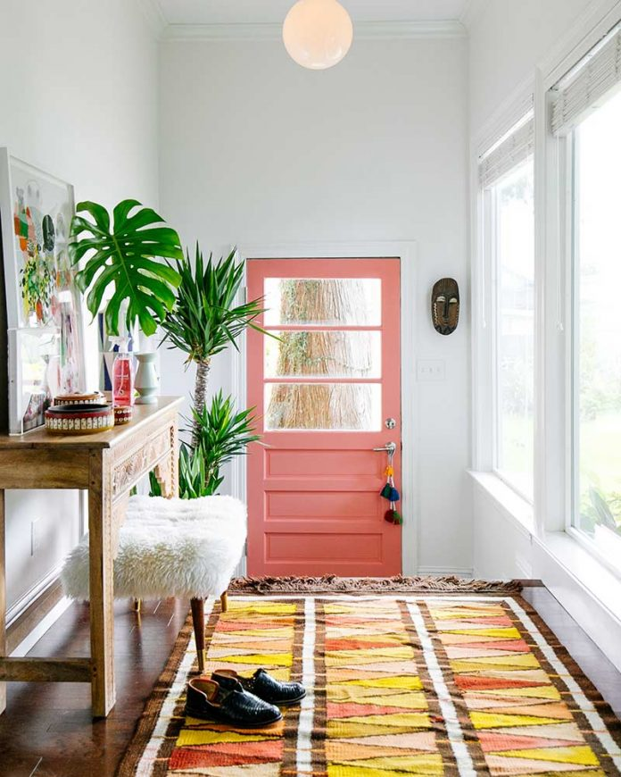 Bright boho foyer with coral door