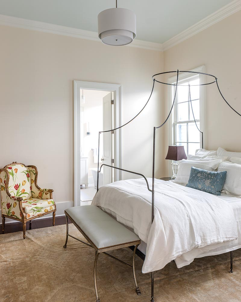 master suite with metal bed frame
