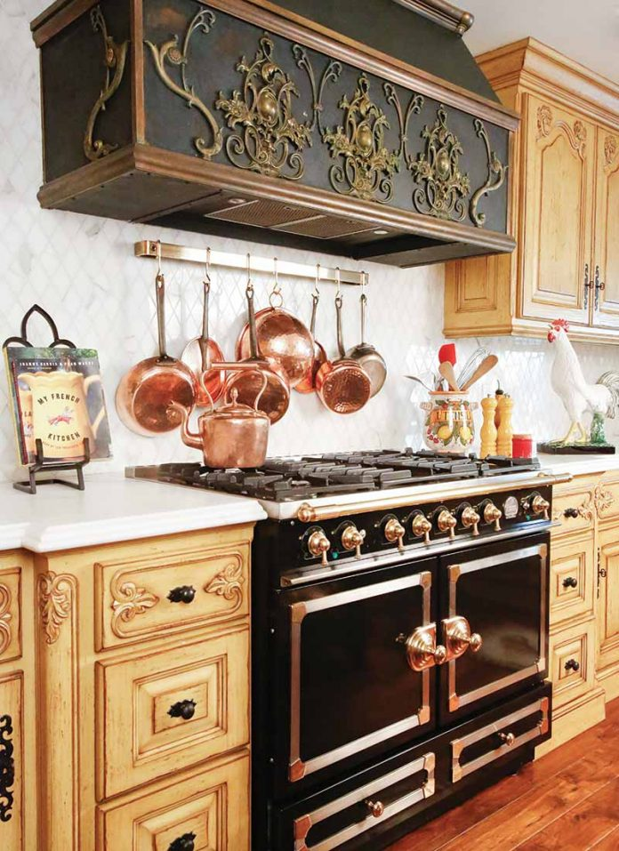French-style range in black with gold finishes