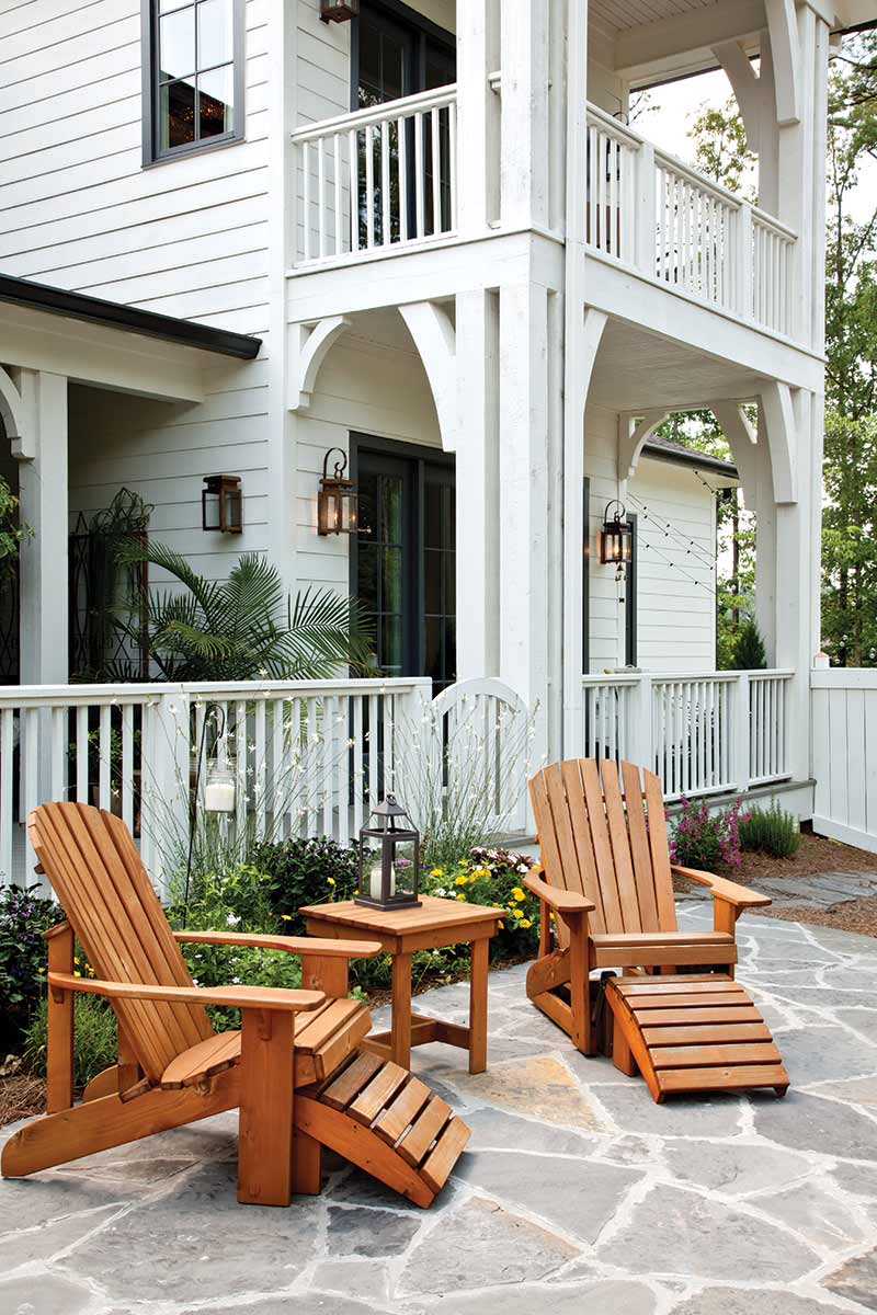 lounge chairs outside of white home