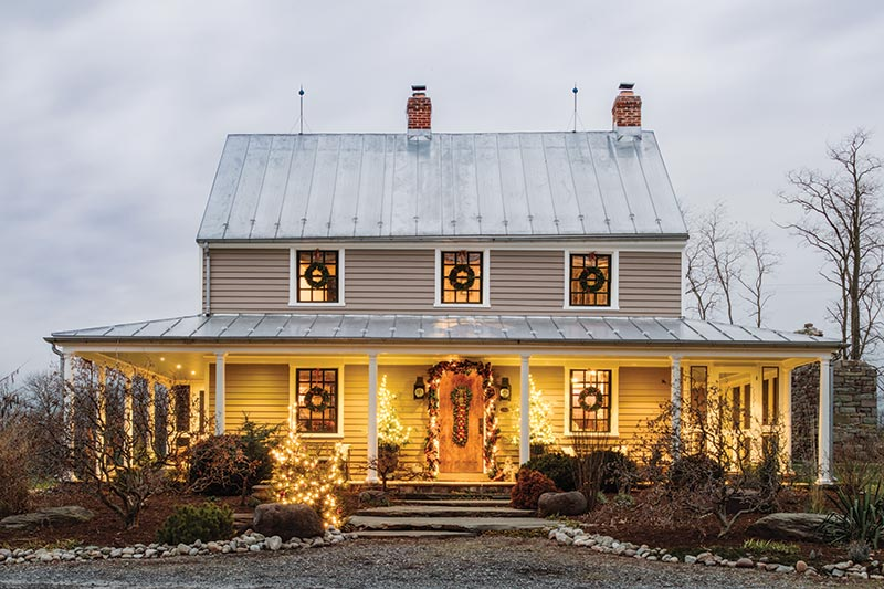 Christmas lights on farmhouse exterior