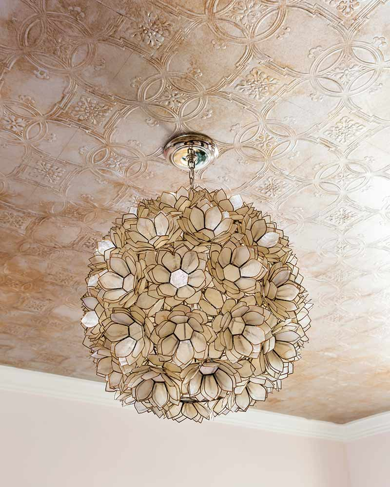 blush pink toled ceiling and glass flower sphere chandelier