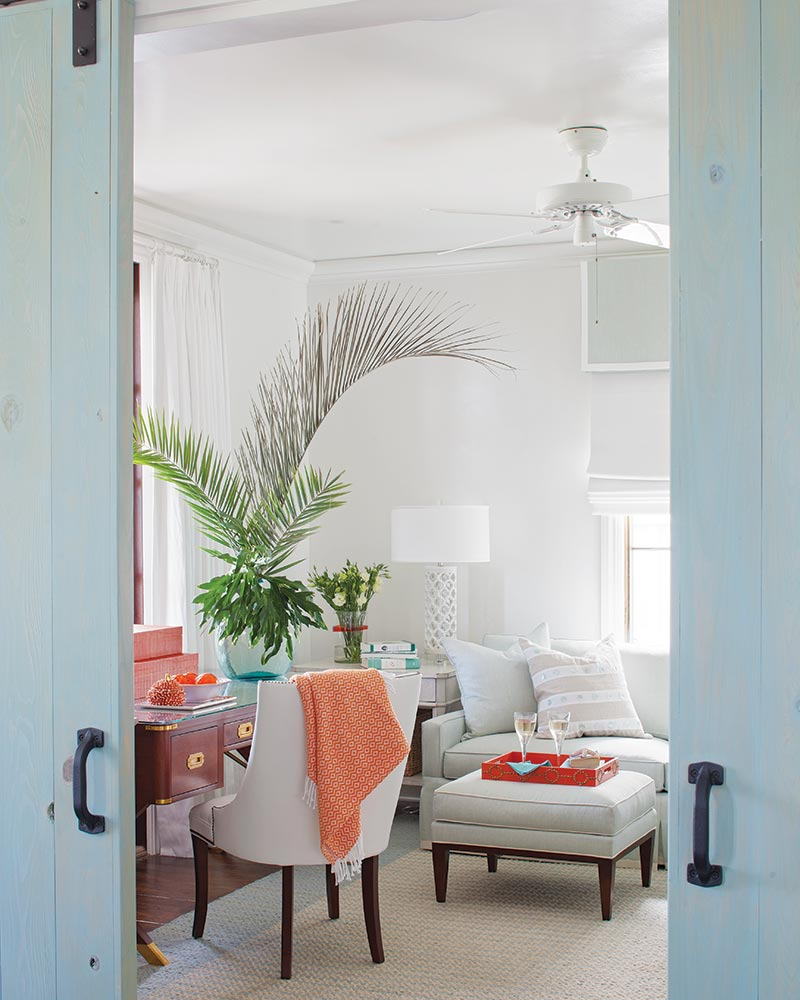 bright beach cottage study with light blue sliding doors